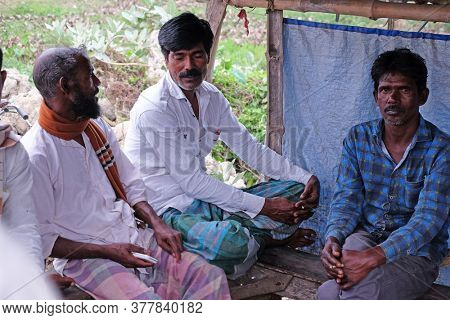 KUMROKHALI, INDIA - FEBRUARY 24, 2020: Indian men in a typical tea house in Kumrokhali village, West Bengal, India