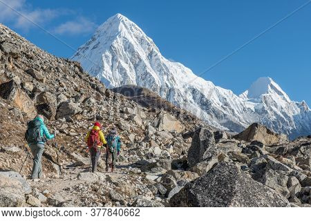 Group Of Trekkers Trekking To Everest Base Camp In Sagarmatha National Park Of Nepal With View Of Mt