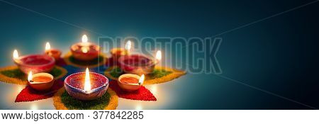 Happy Diwali, Diya Oil Lamps Lit On Colorful Rangoli With Copy Space