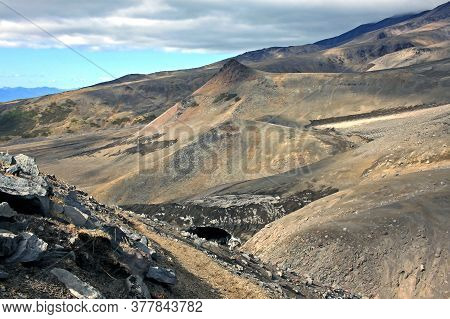 Rock Massif Near Volcanoes Avachinsky And Koryaksky In Kamchatka Peninsula, Russia