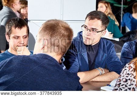 Kirov, Russia - September 25, 2019: People At Table In Cafe Or Restaurant During Intellectual Game.