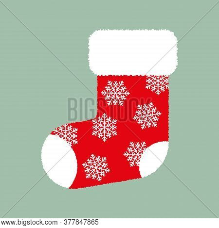 Red Fluffy Christmas Stocking With White Snowflakes On Green Background. Vector Christmas Gift Sock.