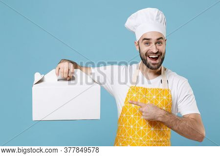 Excited Bearded Male Chef Or Cook Baker Man In Apron White T-shirt Toque Chefs Hat Isolated On Blue