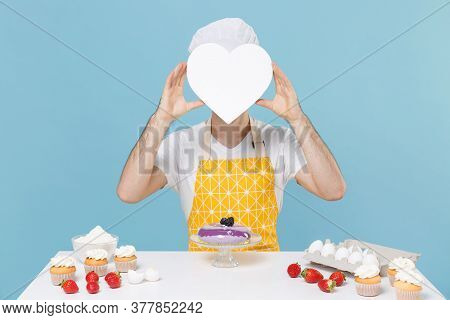 Young Male Chef Or Cook Baker Man In Apron White T-shirt Toque Chefs Hat Cooking At Table Isolated O