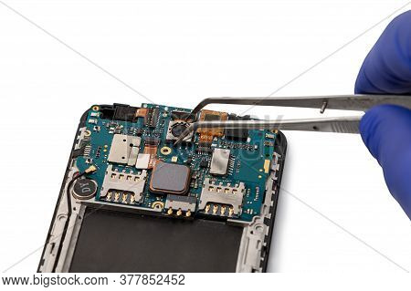 A Technician Repairs A Smartphone Camera Module. Smartphone Repair Concept. Camera Of The Smartphone