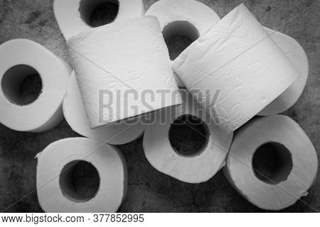 Many Toilet Paper Rolls On A Gray Background. Diarrhea, Constipation Concept