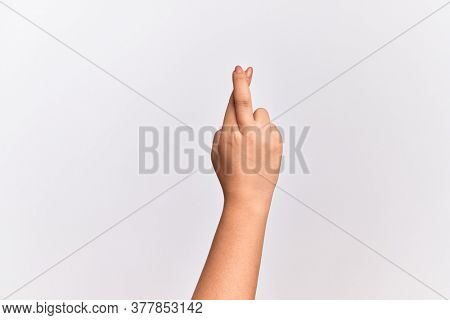 Hand of caucasian young woman gesturing fingers crossed, superstition and lucky gesture, lucky and hope expression