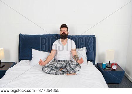 Man Pajamas Sit Bed Bedroom Morning Meditation, Peace Of Mind Concept.