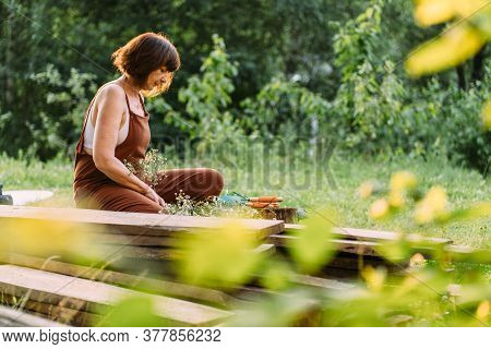 Portrait Photo Of Happy Senior Caucasian Woman Smiling And Relaxing In Outdoors Nature. Elderly Woma