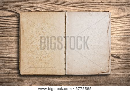 Vintage Book Over Old Wooden Table.