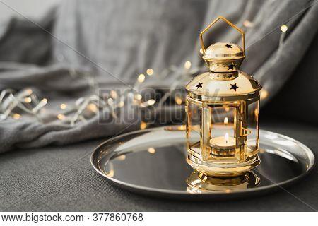 Golden Lantern With Burning Candle On A Metal Tray. Festive Home Decor For Eid Al Adha Or Ramadan Ho