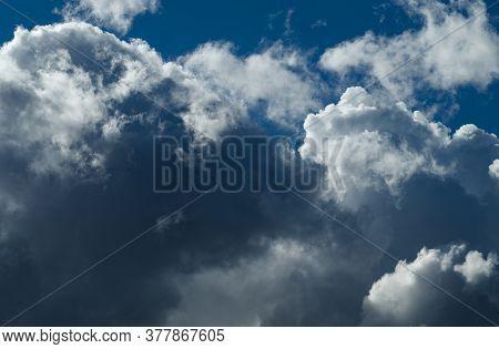 Cumulonimbus Clouds In The Blue Sky Sunny Day