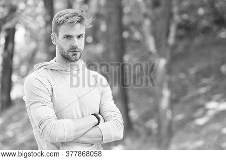 Confident And Physically Fit. Confident Athlete Keep Arms Crossed Outdoors. Confident Look Of Muscul