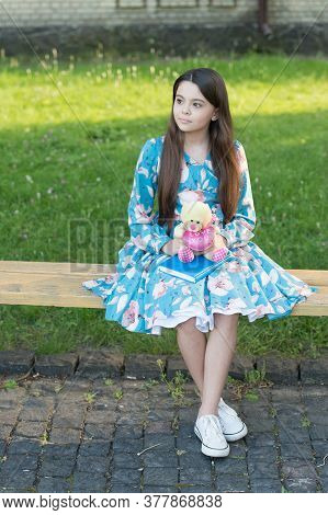 Childhood Games. Happy Child Hold Teddy Bear Outdoors. Little Girl Play With Toy. Childhood Playmate