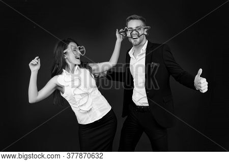 We Love Fun. Happy Couple Have Fun Dark Background. Sexy Girl And Handsome Man Wear Giant Fun Glasse