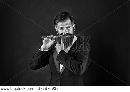 Bearded And Hairy. Bearded Man Hold Razor Dark Background. Businessman With Bearded Face. Unshaven H