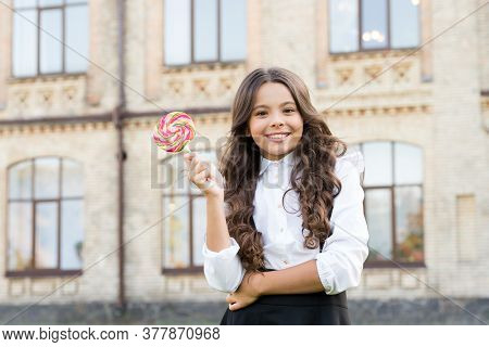 Schoolgirl Relaxing. School Nutrition. Sugar Diet. Sweet Joy. Happy Kid With Sweet Candy. Happy Chil