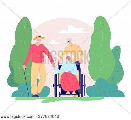 Group Of Old People Walking Outdoor. Old Man And Woman In A Wheelchair Walking In A Park. Recreation