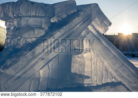 A Fragment Of A Decorative Hut Carved From A Block Of Ice On The Background Of The City Landscape. C