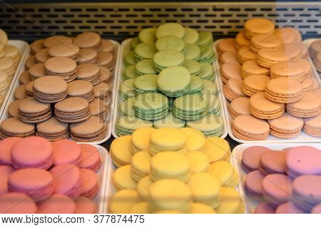 Top View Of Mixed Strawberry, Caramel, Chocolate, Pistachio And Lemon Colourful French Macarons With