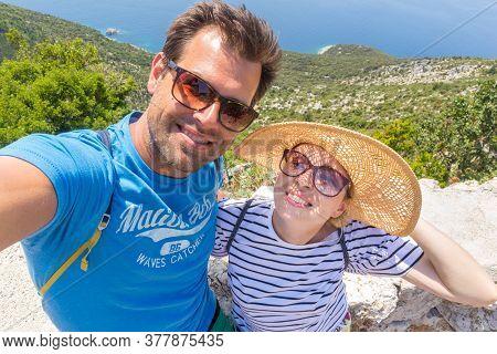 Beautiful, Romantic Caucasian Couple Taking Selfie Self Portrait Photo On Summer Vacations On Adriat