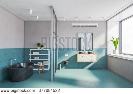 Interior Of Stylish Bathroom With Blue Tiled And Gray Walls, Comfortable Bathtub, Double Sink With T