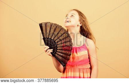 Cooling And Ventilation. Summer Heat. Fresh Air. Kid Girl Fanning Herself With Fan. Conditioning Sys
