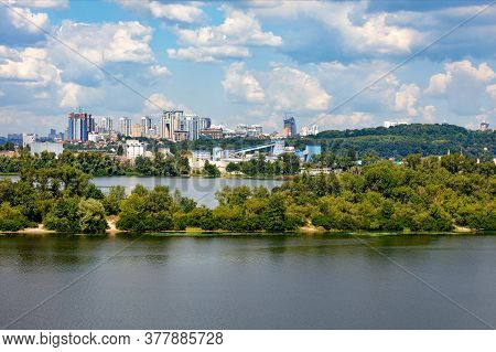 Cityscape Of The Right Bank Of Kiev With The Dnieper River And Islands In The Foreground And A View