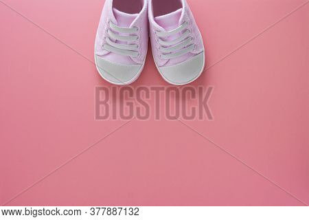 Newborn Baby Girl Background. Top View Of Pink Baby Girl Sneakers Or Shoes, On Pink Background, Copy