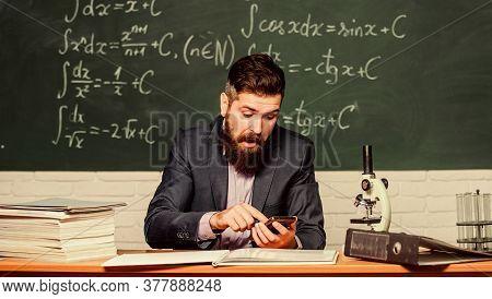 Mobile Teaching. Bearded Man Hold Mobile Phone At Lesson. School Teacher Use Mobile Internet. E-lear