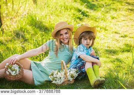 Spring Mood. Portrait Mom And Little Son Outdoor. Cheerful Child With Mother Play Outdoors In Park.