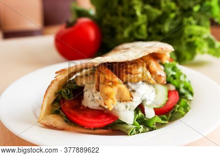 Turkish Fast Food - Chicken In Pita Bread, Doner Kebab - Fried Chicken Meat With Vegetables In Pita