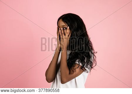 Scared. Cheerful African-american Young Woman Isolated On Pink Background, Emotional And Expressive.