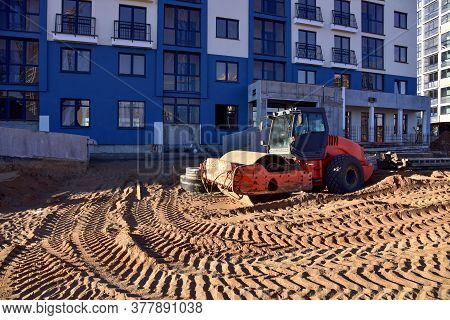Soil Compactor At Construction Site. Vibration Single-cylinder Road Roller For Leveling Soil, Gravel
