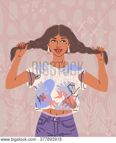 A Beautiful Happy Girl Shows Tongue. A Funny Woman In A Good Mood Holds Her Hair, Two Pigtails. Brig