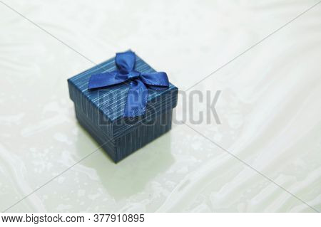 Rectangular Ring Box . Blue Jewelry Gift Box . Marriage Proposal Concept . Blue Ring Box .