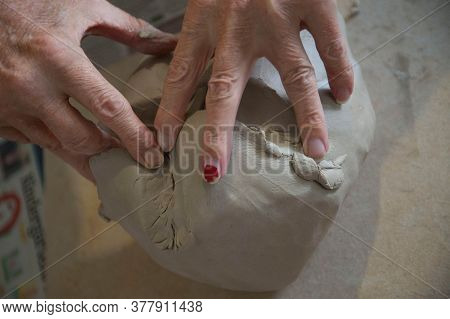 A Hand Touching A Ball Of Clay, Human Tactile And Haptic Perception