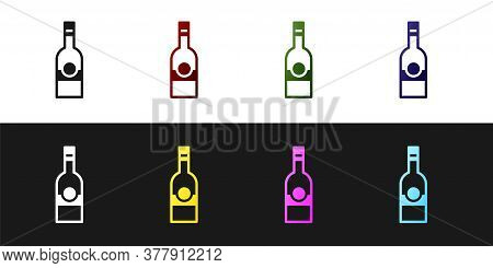Set Glass Bottle Of Vodka Icon Isolated On Black And White Background. Vector