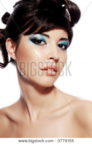 Young Woman Face With Multicolored Make-Up