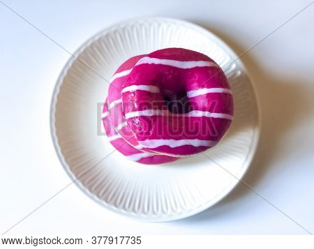 Pink And White Donuts Close-up On White Plate On White Background. Top View. Junk Food. Dessert. Cop