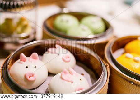 Cute and delicious chinese cuisine dim sum served in small steamer baskets at restaurant