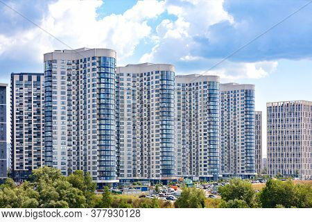 White And Blue Facades Of New Residential High-rise Buildings In A Residential Area Of The City Agai