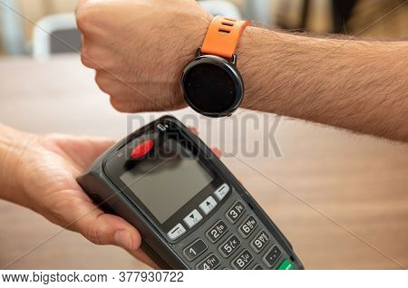 Pos Terminal For Payment With Smart Watch Nfc Technology. Cashier And Customer Hands