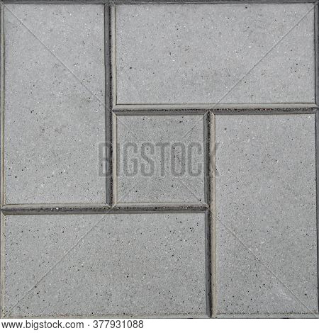 Square Concrete Tile With Geometric Patterns. Tiled Mosaic Concrete Pavement Of The Road. Cement Bac