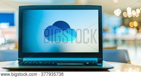 Laptop Computer Displaying Logo Of Microsoft Onedrive