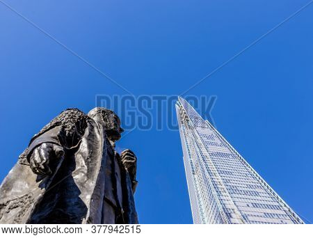 June 2020. London. The Shard And Viscount Nuffield Statue London England