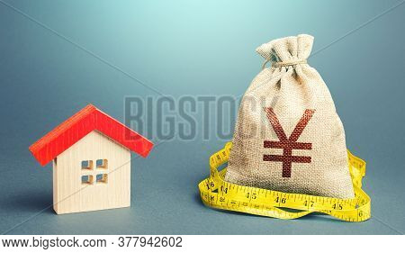 House And A Yen Yuan Money Bag. Mortgage Loan. Property Real Estate Valuation. Buying And Selling, F