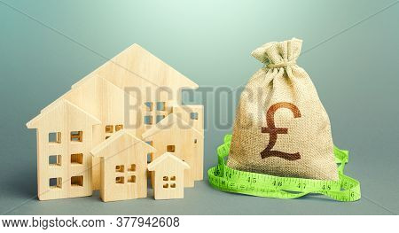 Residential Houses And A British Pound Sterling Money Bag. Property Real Estate Valuation. Mortgage