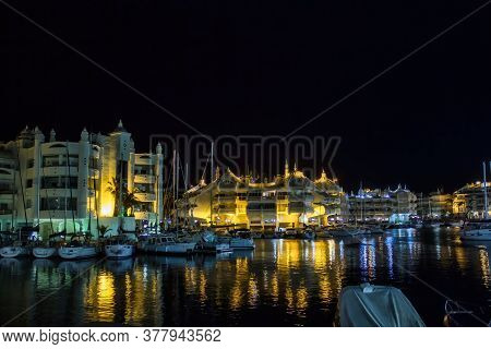 Malaga, Spain - September 03, 2015: Night View Of Market Place With Parked Boats And Building With S