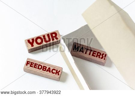 Wooden Blocks With Text Your Feedback Matters In A Box On A White Background